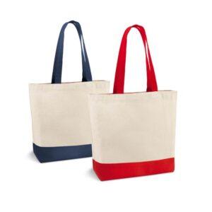 Sacola de algodão canvas: 280 g/m². Com bolso interior e alças de 65 cm. Peça na cor azul ou vermelha.